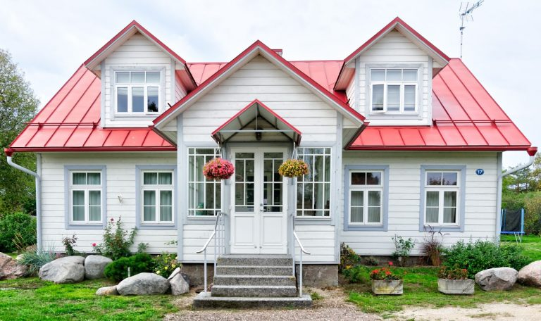 a white home with a red roof